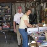 Sorting books for the tag sale - Jack Braddock and Sandy Smith